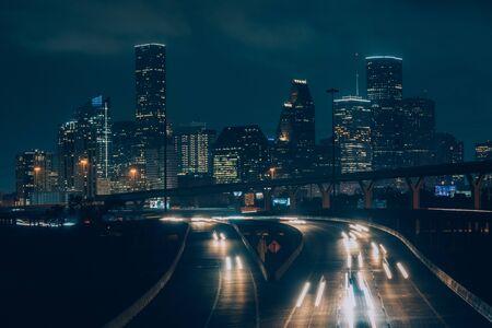 Cityscape photo of the Houston skyline at night, in Houston, Texas Stock Photo