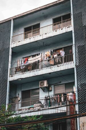 Laundry hanging on balconies in Binondo, Manila, The Philippines