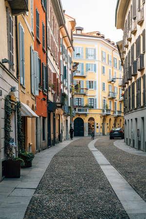 A colorful cobblestone street in Brera, Milan, Italy.