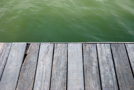 Slat floor and the water in this photo taken at Pier Park. photo