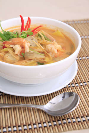 Tom yam Goong, spicy thai soup with shrimp photo