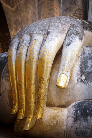 Gold hand of buddha.