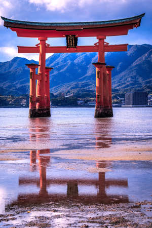 Torii and old japan shine in colorful leaf and tree in Miyajima Islands : Japan