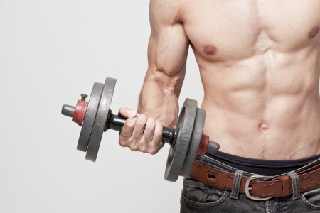 man lifting weights: fitness Stock Photo