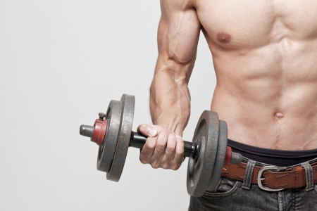 muscle man posing with the dumbbell Stock Photo - 20548146