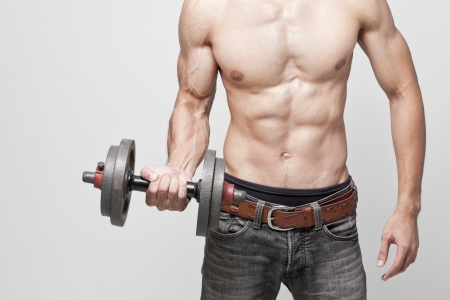 muscle man posing with the dumbbell Stock Photo - 20548147