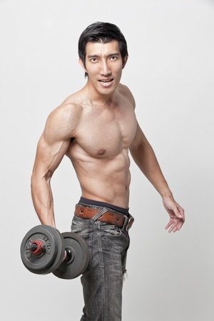 muscle man posing with the dumbbell photo