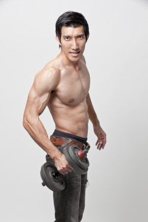 muscle man posing with the dumbbell Stock Photo - 20547862