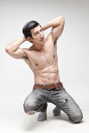 muscle man topless posing photo