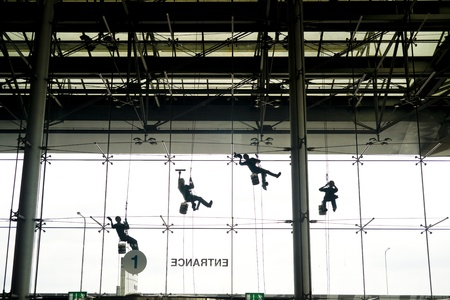 Window washers seen from inside the building