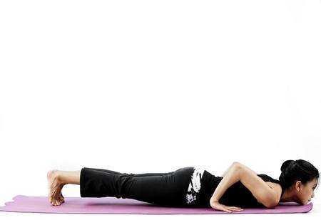 Thai Woman stretching with a yoga pose - Catura  7749;ga Da  7751;  7693;  257;sana Pose Stock Photo