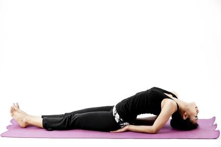 model fish: Asian female practising yoga in fish pose Stock Photo