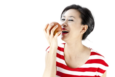 Close up of woman in red stripes dress posing with a fruit photo