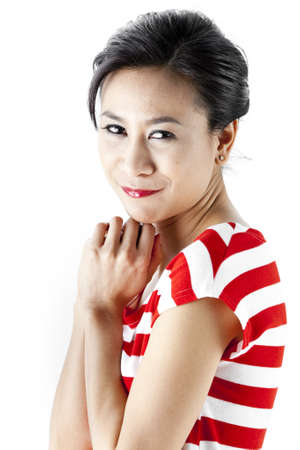 Young asian woman in red stripes dress posing photo