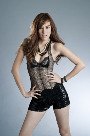 Sexy slim woman in fashionable attire photo