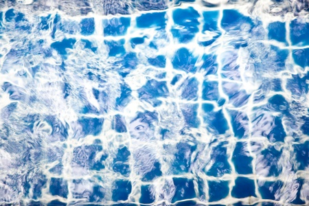 Blue tiles in the swimming pool photo