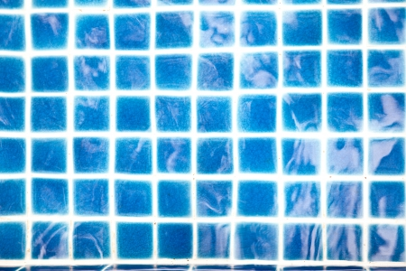 Blue tiles in the swimming pool Stock Photo - 22151580