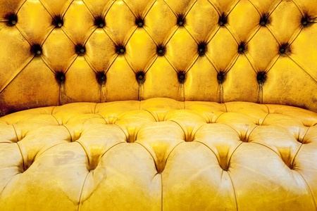 button tufted: Brown leather upholstery background Stock Photo