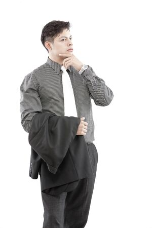 Businessman is having blazer on hand and another hand on chin photo