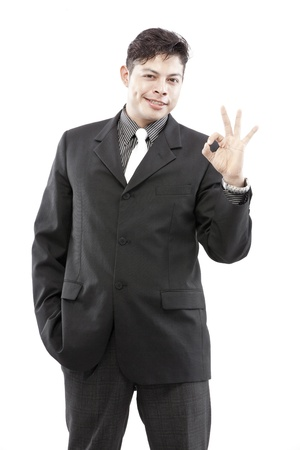 Portrait of a businessman showing hand sign