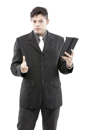 Businessman holding tablet and give the expression of his face photo