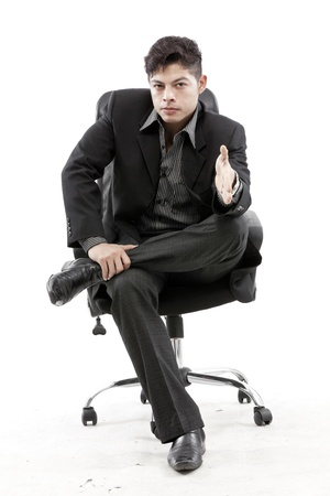 Businessman sitting on chair against white background photo