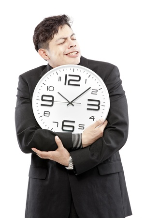 timezone: A young businessman with analog clock on white background
