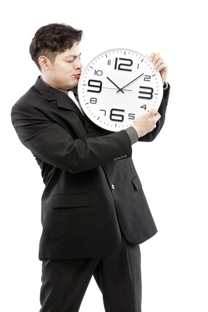 timezone: Close-up of a young businessman with analog clock on white background