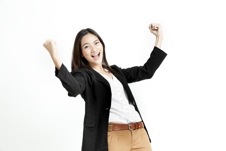 relieved: Young business woman posing with her fists isolated on white background Stock Photo
