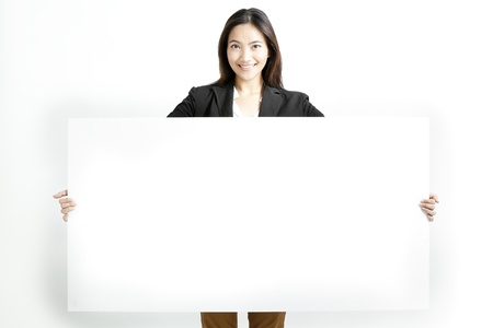 Young business woman holding a blank banner isolated on white background
