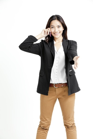 Young business woman on the phone isolated on white background