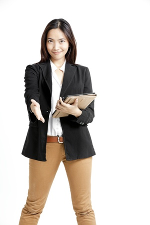 Young business woman holding a tablet computer isolated on white background photo