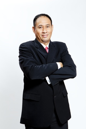 Mature businessman standing against white background