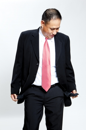 emptied: Mature businessman with emptied out pockets