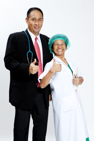 Senior doctor with nurse gesturing thumbs up photo