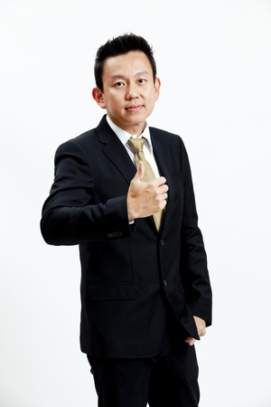 Portrait of businessman with thumb up isolated on white background Stock Photo