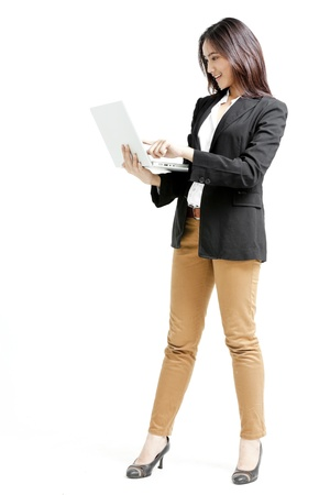 Young business woman with a laptop isolated on white background Stock Photo - 22304961