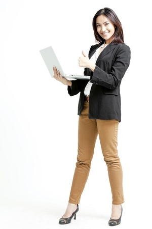 Young business woman with a laptop isolated on white background