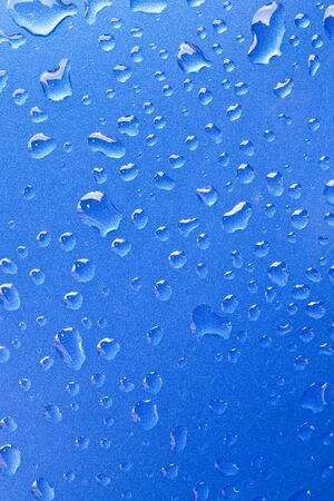 Close-up of water droplets on metal surface as background photo