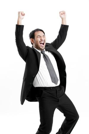 Businessman in suit celebrating success