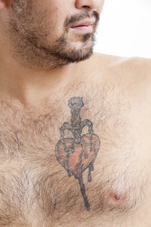 Shirtless Asian man with chest tattoo Stock Photo