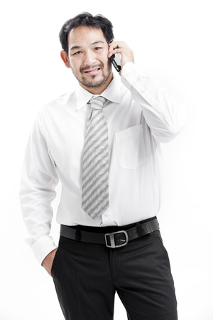 shirtsleeves: Businessman in shirt and tie with cellphone