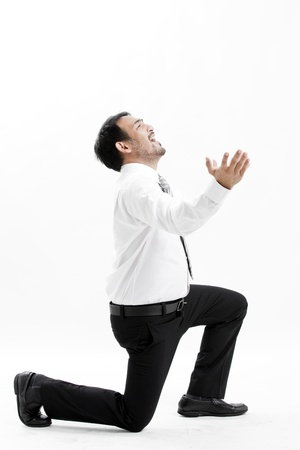 Businessman kneeling and expressing frustration Stock Photo - 22776902