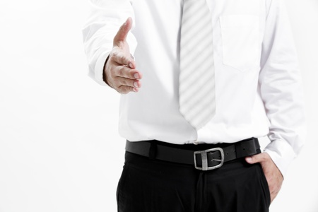 midsection: Businessman in shirt and tie offering handshake Stock Photo