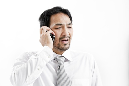 shirtsleeves: Businessman in shirt and tie talking on the phone Stock Photo