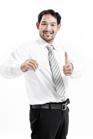 Businessman offering blank business card with thumbs up photo