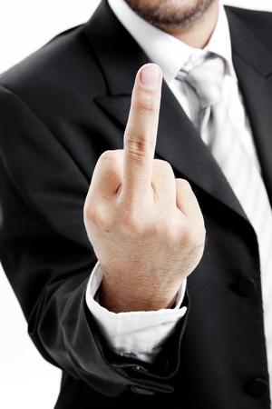 mittelfinger: Gesch�ftsmann in Anzug und Krawatte zeigt Mittelfinger