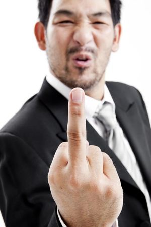 middle finger: Businessman in suit and tie showing middle finger Stock Photo