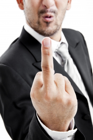 Businessman in suit and tie showing middle finger photo