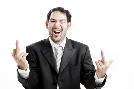 swearing: Businessman in suit and tie cursing with middle finger